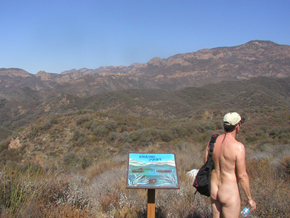 Hiker takes a break to enjoy the view of the Santa Monica Mountains